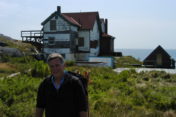 Robert Leedy scouting a spot to start a painting of the Manan Coast Guard Station. Photo by unknown innocent bystander.