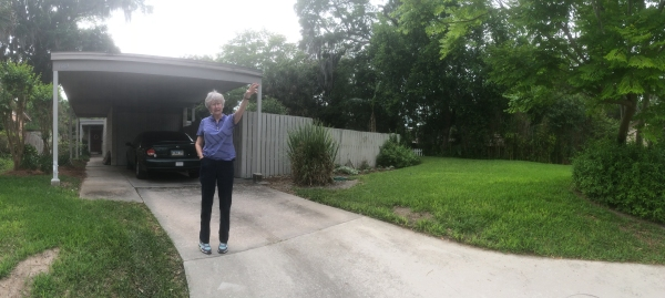Betty Williamson points out the problems on her street. She is the owner of the home behind her, A Gene Leedy Mid-Century Modern design from the late 1950's.